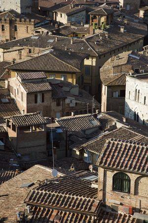 terra: Terra cotta rooftops, Siena, Italy. Stock Photo