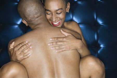 adult sex: Sexy  African-American couple embracing.