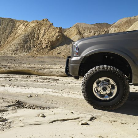 dirt road recreation: Four wheel drive truck in desert landscape in Death Valley National Park.