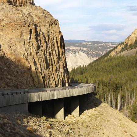 treacherous: Highway winding through steep Wyoming mountains. Stock Photo