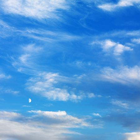 the silence of the world: Wispy cloud formations against clear blue sky.