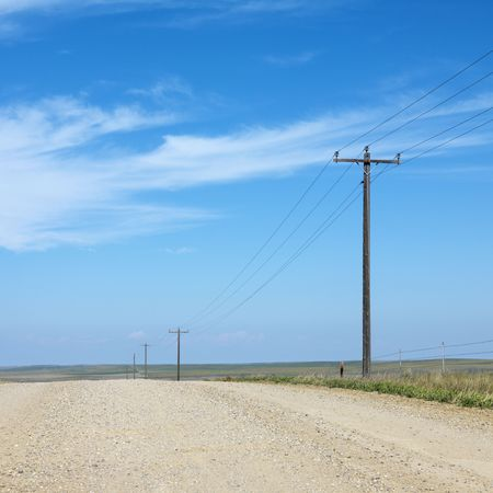 Power lines alongside dirt road in rural South Dakota. photo