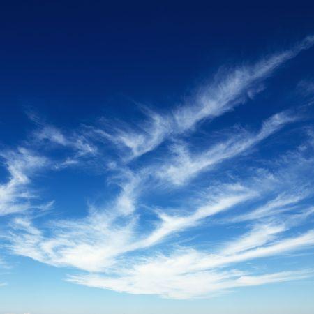 cirrus: Wispy cirrus clouds in blue sky. Stock Photo