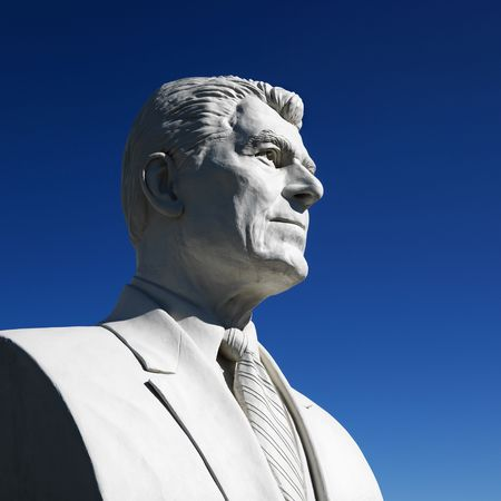 ronald reagan: Bust of Ronald Reagan sculpture against blue sky in Presidents Park, Black Hills, South Dakota. Stock Photo