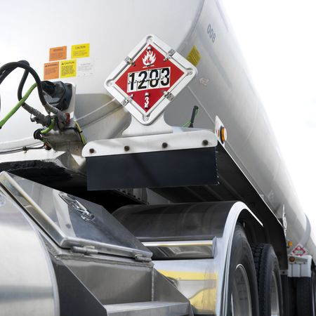 18 wheeler: Fuel tank truck with flammable warning sign on back.