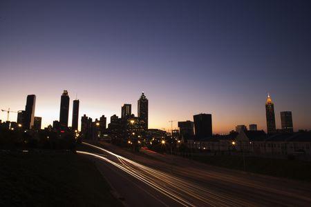 Nightscape of Atlanta, Georgia skyline with blurred automobile lights on highway. photo