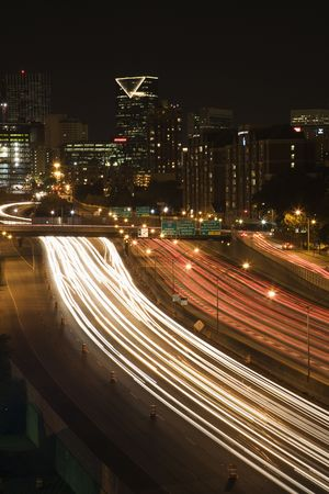 Nightscape of Atlanta, Georgia skyline with blurred automobile lights on highway in foreground. photo
