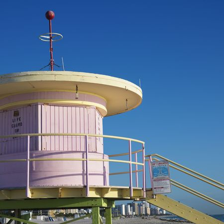sunshine state: Pink art deco lifeguard tower closed up on beach in Miami, Florida, USA.