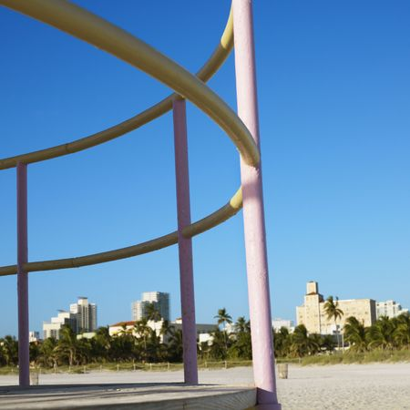 sunshine state: Pink and yellow painted railings of lifeguard tower on beach in Miami, Florida, USA.