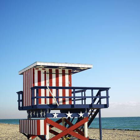 lifeguard tower: Lifeguard tower painted red, white and blue with stars and stripes on beach in Miami, Florida, USA.