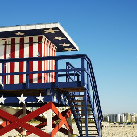 sunshine state: Lifeguard tower painted red, white and blue with stars and stripes on beach in Miami, Florida, USA.
