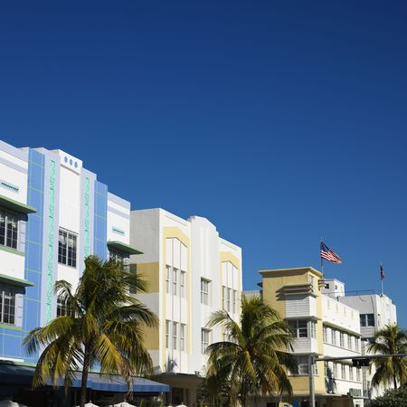 sunshine state: Palm trees and buildings in art deco district of Miami, Florida, USA. Stock Photo
