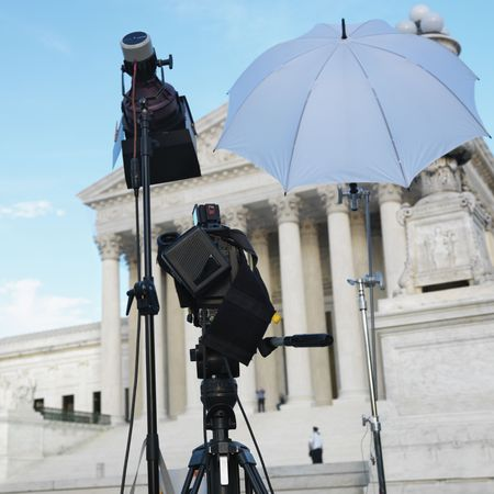 TV production set with camera and lighting equipment on tripods in front of Supreme Court building in Washington DC, USA. Stock Photo