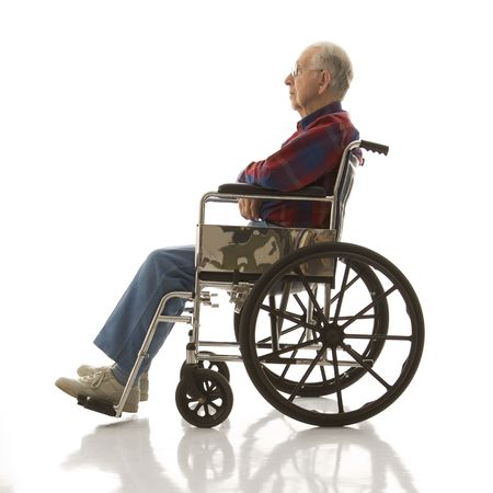 profile: Profile view of Caucasion elderly man sitting in wheelchair.