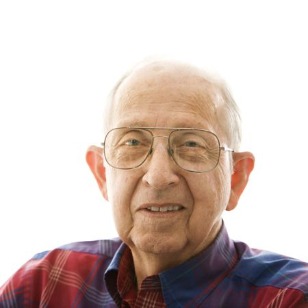 Portrait of smiling Caucasion elderly man in a plaid shirt and glasses. Stock Photo - 2389038