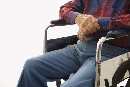 Torso shot of Caucasion elderly man sitting in wheelchair. Stock Photo - 2245928