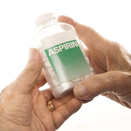 aspirin: Close-up of elderly male Caucasion hands holding aspirin bottle.