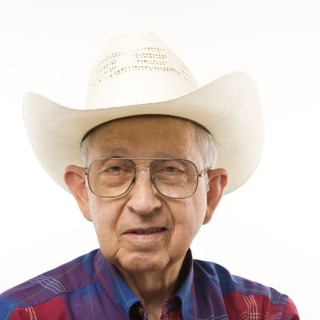 Portrait of Caucasion elderly man wearing plaid shirt and cowboy hat. Stock Photo - 2389032