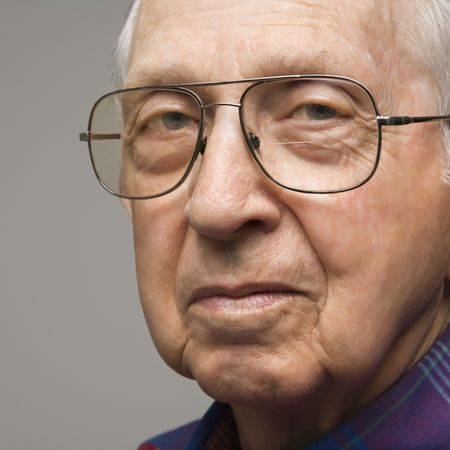 Close-up portrait of elderly man in glasses. Stock Photo - 2388984