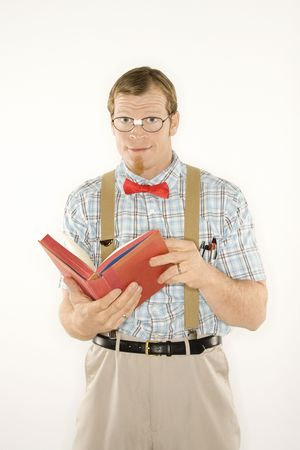 dweeb: Caucasian young man dressed like nerd with book open looking at viewer. Stock Photo