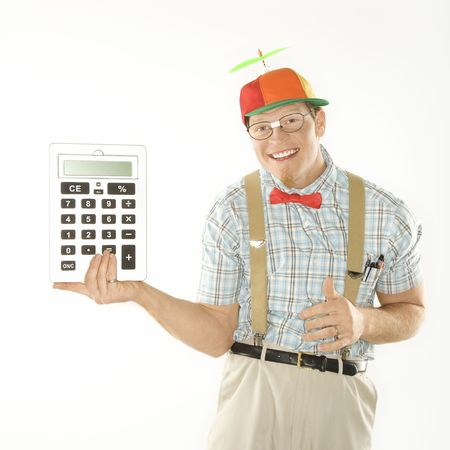 dunce cap: Caucasian young man dressed like nerd wearing beanie holding large calculator.
