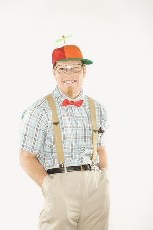 beanie: Caucasian young male nerd wearing propeller cap smiling.