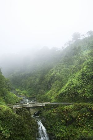 Mist above waterfall on the Road to Hana, Hana Highway, Hawaii, USA. photo