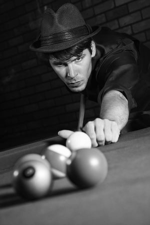 snooker hall: Prime adult Caucasian retro male shooting pool.