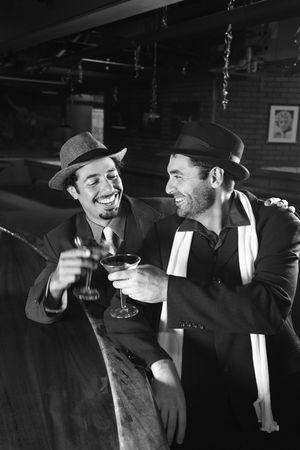 prime adult: Caucasian prime adult retro males sitting at bar drinking.
