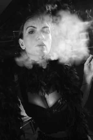 prime adult: Caucasian prime adult female smoking looking at viewer.