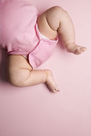 babys: Close up of Asian babys chubby legs. Stock Photo