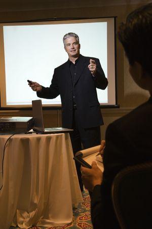 prime adult: Prime adult Caucasian businessman giving presentation. Stock Photo