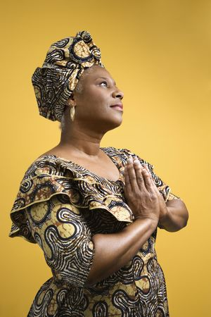 kwanzaa: African American mature adult female dressed in African costume.