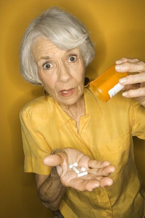 Caucasian mature adult female with medication. Stock Photo - 2376341