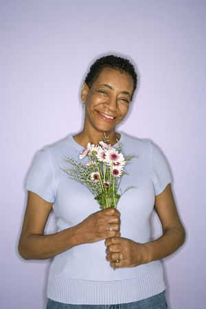 African American mature adult female holding flowers. Stock Photo - 2376528