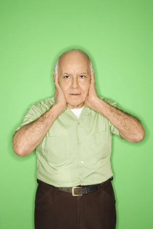 hands over ears: Caucasian mature adult male with hands over ears.