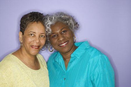 mature adult women: Mature adult African American females looking at viewer smiling.