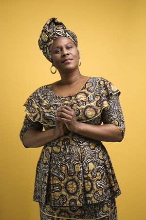 cultural and ethnic clothing: African American female mature adult in African dress.