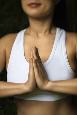 Portrait of Asian American woman in fitness attire standing in yoga position. Stock Photo - 2537800