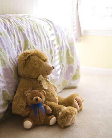 Plush brown teddy bears on bedroom floor. Stock Photo - 2576561