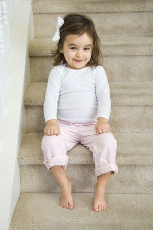 Caucasian girl toddler sitting on carpeted stairs. Stock Photo - 2555141