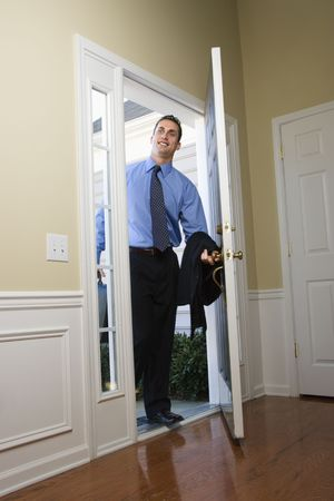 open house: Caucasian businessman   at open door with briefcase.