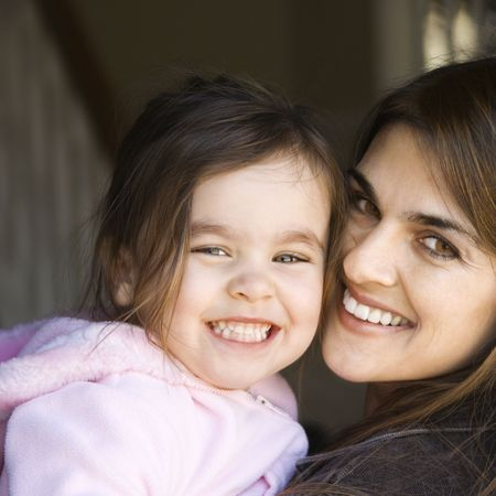 Caucasian mother holding daughter and smiling. Stock Photo - 2555843