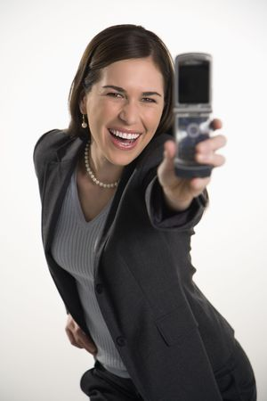 phone business: Caucasian mid adult professional business woman taking picture of self with camera phone and smiling. Stock Photo