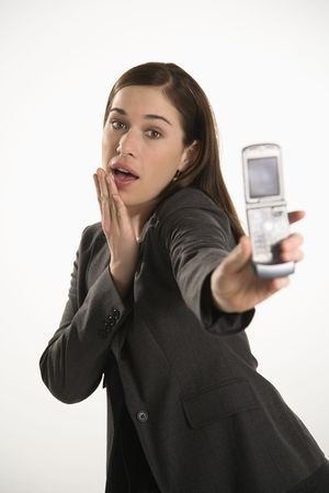 Caucasian mid adult professional business woman taking picture of self with camera phone with hand on chin. Stock Photo - 2555064