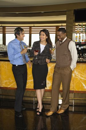 Diverse mid adult friends at bar drinking. Stock Photo - 2555211
