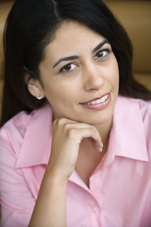 Mid adult Hispanic woman smiling at viewer with hand to head. Stock Photo - 2555643