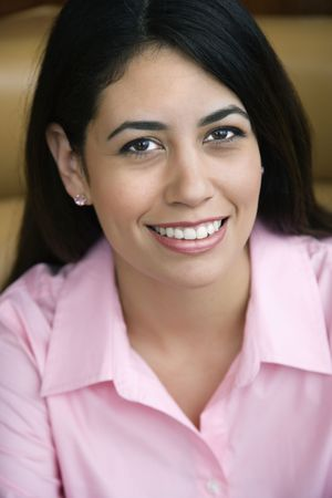 Mid adult Hispanic woman smiling at viewer. Stock Photo - 2555611