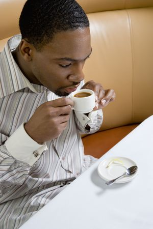 expresso: African American mid adult man drinking expresso.