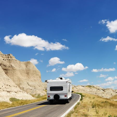 badlands: Recreational vehicle on scenic road in Badlands National Park, North Dakota.